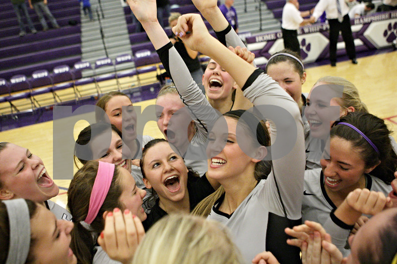 Rob Winner – rwinner@shawmedia.com<br /> <br /> The Kaneland volleyball team celebrates after defeating Sycamore at the Class 3A Hampshire Regional championship on Thursday, Oct. 25, 2012.