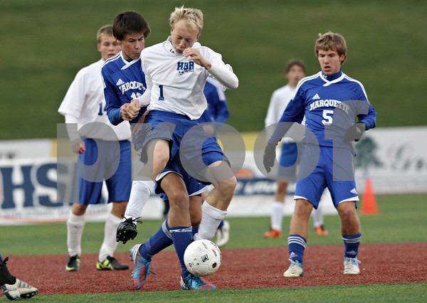 Rob Winner – rwinner@shawmedia.com<br /> <br /> Hinckley-Big Rock's Jared Madden (1) controls a ball ahead of Alton Marquette's Joel Reft in the first half during the Class 1A State semifinal in Normal, Ill., Friday, Oct. 26, 2012. Alton Marquette defeated H-BR, 4-3.