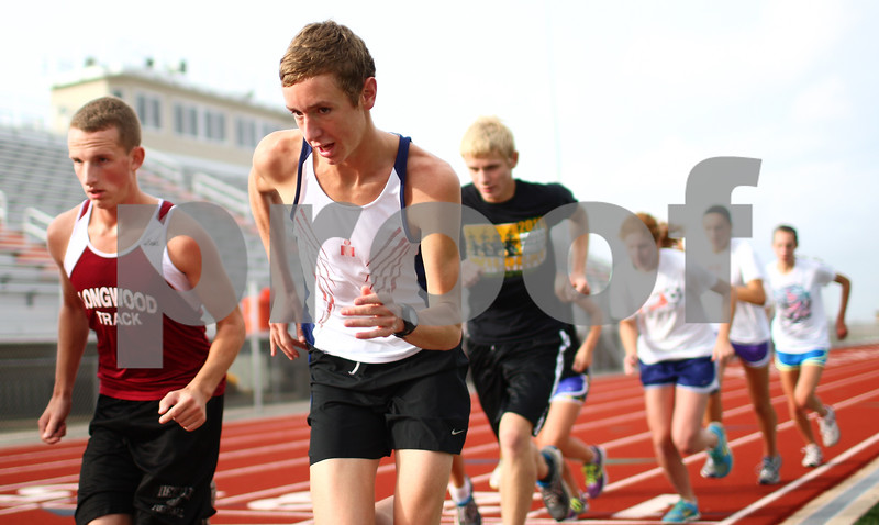 Kyle Bursaw – kbursaw@shawmedia.com<br /> <br /> DeKalb cross country runners Tyler Greenwood (left) and Marc Dubrick (center) take off on a new set of laps on the track at practice on Tuesday, Oct. 23, 2012.