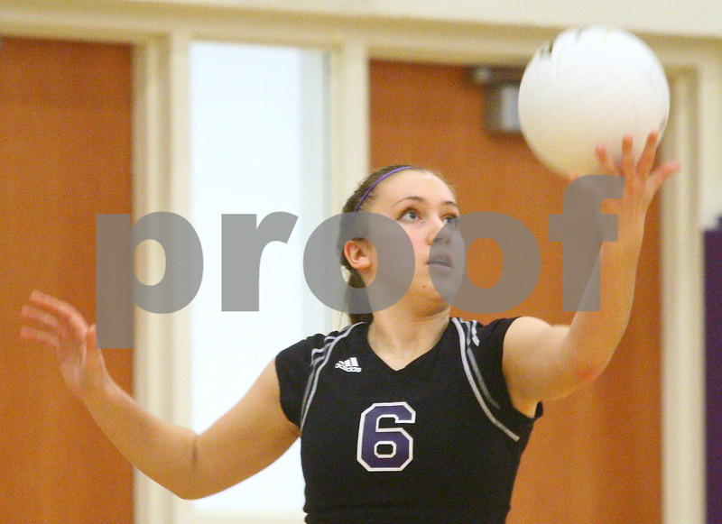 Kyle Bursaw – kbursaw@shawmedia.com<br /> <br /> Hampshire's Brittany Laffin serves the ball during the game against Sycamore in the Class 3A Hampshire regional quarterfinal at Hampshire High School on Monday, Oct. 22, 2012. Sycamore defeated Hampshire 25-16, 25-11.