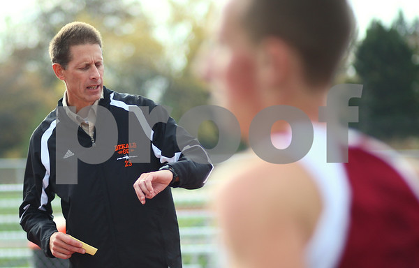 Kyle Bursaw – kbursaw@shawmedia.com<br /> <br /> DeKalb cross country coach Mike Wolf, calls out times during practice at the high school on Tuesday, Oct. 23, 2012.
