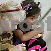 Rob Winner – rwinner@shawmedia.com<br /> <br /> Friends Kaylee Skeens (left), 5, and Julissa Benitez, 7, both of Cortland, eat a piece of cake at the Sycamore Pumpkin Festival Wednesday evening.<br /> <br /> Wednesday, Oct. 24, 2012