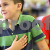 Kyle Bursaw – kbursaw@shawmedia.com<br /> <br /> Alfredo Salinas feels his pulse after doing jumping jacks during a CATCH lesson taught by NIU students Holly Maychszak and Jackie Dugenia in Sonia Enriquez's second grade class at Founders Elementary in DeKalb, Ill. on Wednesday, Oct. 24, 2012.
