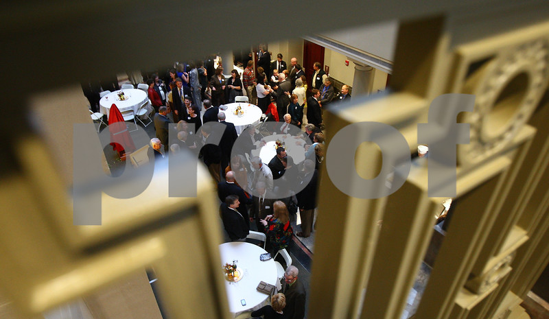 Kyle Bursaw – kbursaw@shawmedia.com<br /> <br /> Seen through the handrails on the upper level of the DeKalb County Courthouse's new atrium area, people socialize at Judge Kurt Klein's retirement party on Thursday, Oct. 18, 2012.