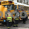 Kyle Bursaw – kbursaw@shawmedia.com<br /> <br /> DeKalb firefighters investigate a school bus that began smoking through the dashboard when it made a stop on Kimberly Drive on Wednesday, Oct. 24, 2012. Children were evacuated and another bus was brought out to finish the route. There were no injuries.