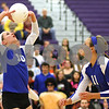 Kyle Bursaw – kbursaw@shawmedia.com<br /> <br /> Genoa-Kingston's Bridget Halat sets the ball as teammate Tori Hensley (right) looks on during their game against St. Edward at Class 3A Hampshire regional quarterfinal at Hampshire High School on Monday, Oct. 22, 2012. St. Edward defeated Genoa-Kingston 25-20, 25-16.