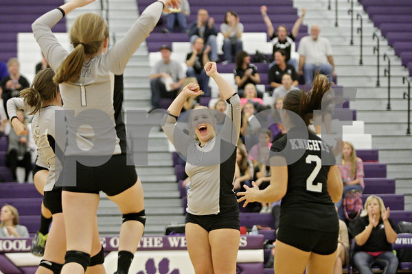 Rob Winner – rwinner@shawmedia.com<br /> <br /> Kaneland's Ashley Post (19) celebrates with her teammates after a point in the first game against St. Edwards during the Class 3A Hampshire Regional semifinals Tuesday, Oct. 23, 2012. Kaneland defeated St. Edwards, 25-17 and 25-18.