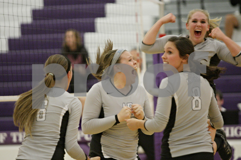 Rob Winner – rwinner@shawmedia.com<br /> <br /> Kaneland's Lauren Banbury (15) celebrates a block that fell for a point during the first game of the Class 3A Hampshire Regional final on Thursday, Oct. 25, 2012. Kaneland defeated Sycamore, 25-19 and 25-23.