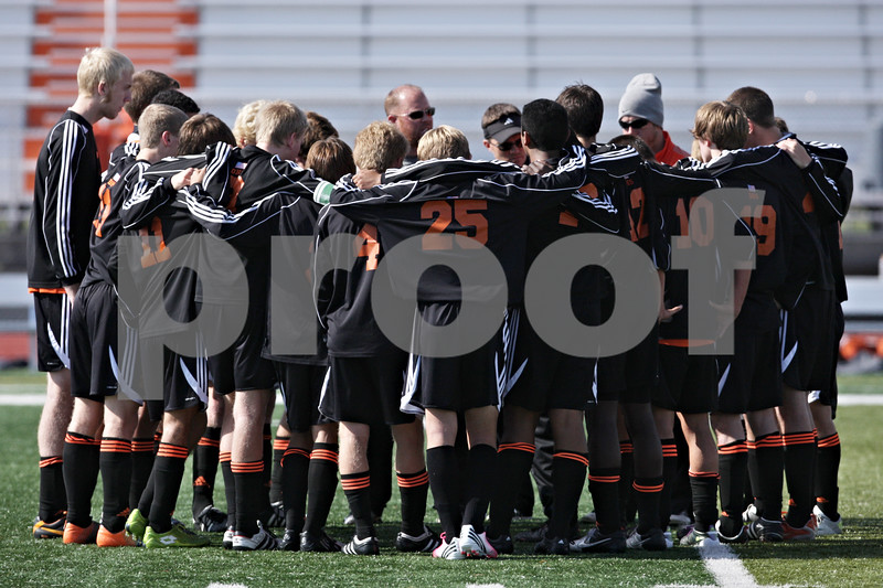Rob Winner – rwinner@shawmedia.com<br /> <br /> The DeKalb soccer team gathers after falling to Huntley during the Class 3A DeKalb Regional final Saturday, Oct. 20, 2012. Huntley defeated DeKalb, 3-1.