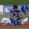 Rob Winner – rwinner@shawmedia.com<br /> <br /> Hinckley-Big Rock's Jared Madden (bottom) is tripped up by Alton Marquette's Joel Reft in the first half during the Class 1A State semifinal in Normal, Ill., Friday, Oct. 26, 2012. Alton Marquette defeated H-BR, 4-3.