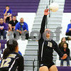 Kyle Bursaw – kbursaw@shawmedia.com<br /> <br /> Sycamore's Brittany Huber hits the ball over the net as teammate as teammate Mattie Hayes looks on in the Class 3A Hampshire regional quarterfinal at Hampshire High School on Monday, Oct. 22, 2012. Sycamore defeated Hampshire 25-16, 25-11.