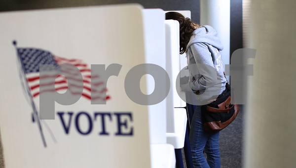 Kyle Bursaw – kbursaw@shawmedia.com<br /> <br /> Northern Illinois University student Alejandra Tena, 18, fills out her ballot on the first day of early voting at the Holmes Student Center on Monday, Oct. 22, 2012.