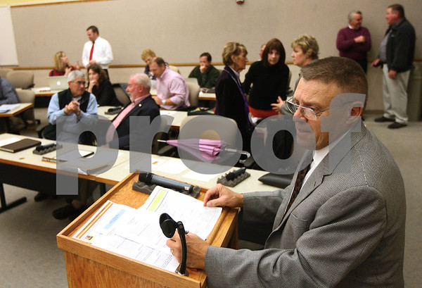 Kyle Bursaw – kbursaw@shawmedia.com<br /> <br /> DeKalb County Board President Larry Anderson talks to DeKalb County Clerk John Acardo (not pictured) before the board meeting on Wednesday, Oct. 17, 2012. All the seats in the board are up for reelection, including the presidency as Anderson is not seeking reelection.