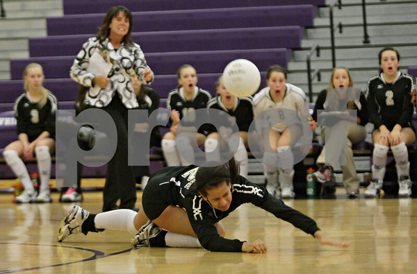 Rob Winner – rwinner@shawmedia.com<br /> <br /> Sycamore's Mattie Hayes is unable to save a ball during the first game of the Class 3A Hampshire Regional final on Thursday, Oct. 25, 2012. Kaneland defeated Sycamore, 25-19 and 25-23.