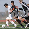 Rob Winner – rwinner@shawmedia.com<br /> <br /> Huntley's Niko Mihalopoulos (left) controls a ball as DeKalb's Andrew Stratton (8) trails in the first half during the Class 3A DeKalb Regional final Saturday, Oct. 20, 2012. Huntley defeated DeKalb, 3-1.