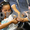 Kyle Bursaw – kbursaw@shawmedia.com<br /> <br /> Briseida Fernando flexes her muscles during a CATCH lesson taught by NIU students Holly Maychszak and Jackie Dugenia in Sonia Enriquez's second grade class at Founders Elementary in DeKalb, Ill. on Wednesday, Oct. 24, 2012.