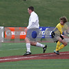 Rob Winner – rwinner@shawmedia.com<br /> <br /> Hinckley-Big Rock's Zach Michels (left) gets past Alton Marquette goalkeeper Zach Horn for the Royals first goal in the first half during the Class 1A State semifinal in Normal, Ill., Friday, Oct. 26, 2012. Alton Marquette defeated H-BR, 4-3.