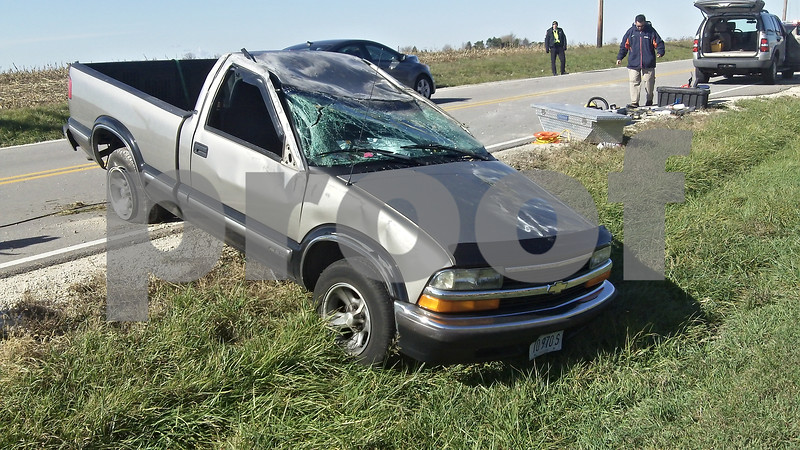 The driver of this crushed Chevy S-10 pickup truck pulled himself out of the truck cab after rolling the vehicle while going southbound on Glidden Road near the Route 64 intersection. The driver was taken to Kishwaukee Community Hospital but appears to be OK.
