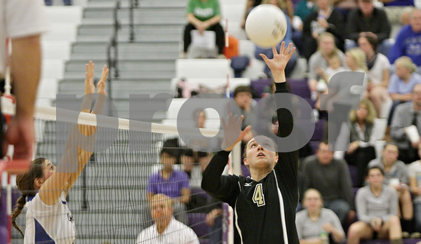 Rob Winner – rwinner@shawmedia.com<br /> <br /> Sycamore's Ratasha Garbes (4) tips a ball over the net for a point in the first game against Burlington Central during the Class 3A Hampshire Regional semifinals Tuesday, Oct. 23, 2012. Sycamore defeated Burlington Central, 25-23 and 25-21.