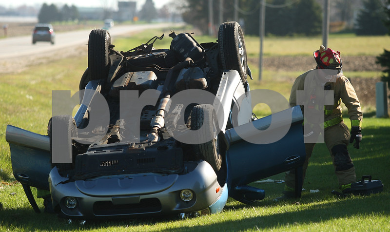 Kyle Bursaw – kbursaw@shawmedia.com<br /> <br /> A Maple Park firefighter works at an accident where one vehicle rolled into the ditch on Lincoln Highway near Hinckley Road in Cortland, Ill. on Monday, Oct. 29, 2012.