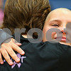 Kyle Bursaw – kbursaw@shawmedia.com<br /> <br /> Seventh-grader Grace Ballas hugs her former teacher Alison Bryant, a breast cancer survivor, after Ballas shaved her head at an all-school assembly at Somonauk Middle School on Wednesday, Oct. 31, 2012. Ballas raised $2,758 for the Susan G. Komen Foundation.