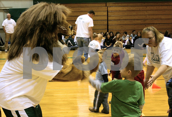 Jeff Engelhardt — jengelhardt@shawmedia.com<br /> <br /> Pre-K students high five Zion the Lion during the Laps for Learning fundraiser at Cornerstone Christian Academy in Sycamore, Ill. on Friday, Nov. 2, 2012. The event raises money for tuition assistance. It generated more than $56,000.