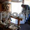 Kyle Bursaw – kbursaw@shawmedia.com<br /> <br /> Kevin Haish opens a box with a foldable cauldron on his porch as he works on setting up his elaborate Halloween decorations at his Sycamore home on Monday, Oct. 29, 2012.