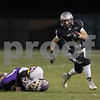 Karen Naess For The Chronicle<br /> <br /> Kaneland's Zack Martinelli avoids the tackle by Belvidere in playoff play on Saturday at Kaneland.