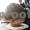 Rob Winner – rwinner@shawmedia.com<br /> <br /> Marc Thompson, 13, of Sycamore, competes in a pie eating contest at the Sycamore Pumpkin Festival Saturday, Oct. 27, 2012.