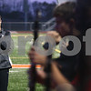 Kyle Bursaw – kbursaw@shawmedia.com<br /> <br /> Steve Lundin, director of the DeKalb High School marching band, assesses the performance of the band as they practice marching around the DeKalb High School track on Wednesday, Oct. 24, 2012.