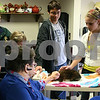 Jeff Engelhardt — jengelhardt@shawmedia.com<br /> <br /> Jessica Drendel (left), Jason Kuhn (center) and Anna Drendel, all members of the Genoa 4-H club pet a rabbit with Mary Peacock, a resident of DeKalb County Nursing & Rehab Center in DeKalb, Ill. on Friday, Nov. 2, 2012.