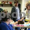 Jeff Engelhardt — jengelhardt@shawmedia.com<br /> <br /> Jessica Drendel (left), Jason Kuhn (center) and Anna Drendel, all members of the Genoa 4-H club pet a rabbit with Mary Peacock, a resident of DeKalb County Nursing & Rehab Center in DeKalb, Ill. on Friday, Nov. 2, 2012.