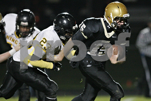 Rob Winner – rwinner@shawmedia.com<br /> <br /> Sycamore quarterback Devin Mottet (15) carries the ball during the fourth quarter in a Class 5A playoff game in Sycamore Saturday, Oct. 27, 2012. Sycamore defeated Chicago King, 35-13.