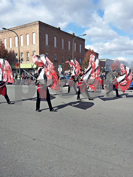 Members of the Northern Illinois University Color Guard marched in the Sycamore Pumpkin Festival parade Sunday.