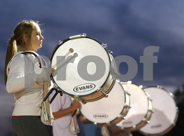 Kyle Bursaw – kbursaw@shawmedia.com<br /> <br /> Emily Corbin and other drummers practice playing 'Dynamite' by Taio Cruz and other songs as they march their way around the track at DeKalb High School during marching band practice on Wednesday, Oct. 24, 2012.