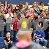 Kyle Bursaw – kbursaw@shawmedia.com<br /> <br /> Seventh-grader Grace Ballas receives a standing ovation from her classmates after her head was shaved at an all-school assembly at Somonauk Middle School on Wednesday, Oct. 31, 2012. Ballas raised $2,758 for the Susan G. Komen Foundation.