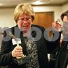 Rob Winner – rwinner@shawmedia.com<br /> <br /> Amy Polzin (left) receives a trophy from Jane Levinsky after being named the 2012 Athena Award recipient at the Best Western DeKalb Inn and Suites Thursday, Nov. 1, 2012.