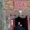 Kyle Bursaw — kbursaw@shawmedia.com<br /> <br /> DeKalb police Sgt. Jason Leverton speaks with an NIU police officer in the doorway of the Pi Kappa Alpha house at 1020 W. Hillcrest Drive in DeKalb where police were investigating the death of NIU freshman David Bogenberger on Friday, Nov. 2, 2012.