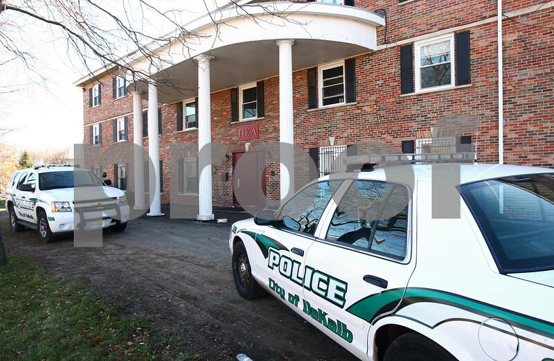 Kyle Bursaw — kbursaw@shawmedia.com<br /> <br /> DeKalb police vehicles sit outside the Pi Kappa Alpha house at 1020 W. Hillcrest Drive in DeKalb where police were investigating the death of NIU freshman David Bogenberger on Friday, Nov. 2, 2012.