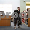 Rob Winner – rwinner@shawmedia.com<br /> <br /> Assistant director Katherine Keyes walks slowly around the Sycamore Public Library as guests played a game of zombie miniature golf on Saturday, Oct. 27, 2012.
