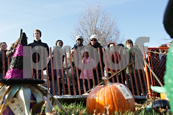 Rob Winner – rwinner@shawmedia.com<br /> <br /> Guests to this year's Sycamore Pumpkin Festival look over the pumpkin entries on the lawn of the DeKalb County Courthouse Saturday, Oct. 27, 2012.