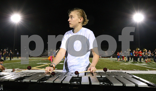 Kyle Bursaw – kbursaw@shawmedia.com<br /> <br /> Lindsey Hellmuth looks to drum major Theresa Nguyen (not pictured) while playing the vibraphone at marching band practice at DeKalb High School on Wednesday, Oct. 24, 2012.
