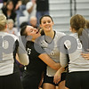 Rob Winner – rwinner@shawmedia.com<br /> <br /> Kaneland libero Shayna Tucek (left) hugs Lyndi Scholl after a kill by Scholl during the second game of the Class 3A Hampshire Regional final on Thursday, Oct. 25, 2012. Kaneland defeated Sycamore, 25-19 and 25-23.