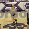 Rob Winner – rwinner@shawmedia.com<br /> <br /> Kaneland's Ellie Dunn (center) celebrates a point during the second game of the Class 3A Hampshire Regional final on Thursday, Oct. 25, 2012. Kaneland defeated Sycamore, 25-19 and 25-23.