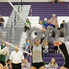 Rob Winner – rwinner@shawmedia.com<br /> <br /> Kaneland's Jenny Lubic (9) tips up a ball for Keri Groen (right) in the first game against St. Edwards during the Class 3A Hampshire Regional semifinals Tuesday, Oct. 23, 2012. Kaneland defeated St. Edwards, 25-17 and 25-18.