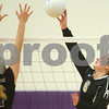 Kyle Bursaw – kbursaw@shawmedia.com<br /> <br /> Sycamore's Hannah Knox tips the ball over the block of Hampshire's Arianna Rominski (left) in the Class 3A Hampshire regional quarterfinal at Hampshire High School on Monday, Oct. 22, 2012. Sycamore defeated Hampshire 25-16, 25-11.