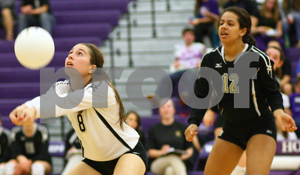 Kyle Bursaw – kbursaw@shawmedia.com<br /> <br /> Sycamore's Christina Dailey controls the ball as teammate Mattie Hayes looks on in the Class 3A Hampshire regional quarterfinal at Hampshire High School on Monday, Oct. 22, 2012. Sycamore defeated Hampshire 25-16, 25-11.