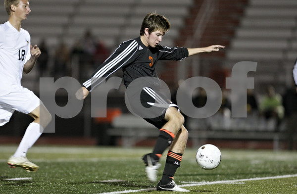 Rob Winner – rwinner@shawmedia.com<br /> <br /> DeKalb's Logan Brown (3) kicks in the Barbs winning goal in the second half of the Class 3A DeKalb Regional semifinal on Tuesday, Oct. 16, 2012. DeKalb defeated Jacobs, 1-0.