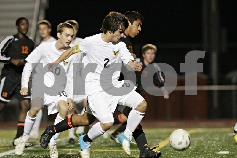 Rob Winner – rwinner@shawmedia.com<br /> <br /> Jacobs' Anthony Moscatello (2) and DeKalb's Gerardo Guadarrama (16) battle for possession in the first half of the Class 3A DeKalb Regional semifinal on Tuesday, Oct. 16, 2012. DeKalb defeated Jacobs, 1-0.