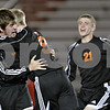 Rob Winner – rwinner@shawmedia.com<br /> <br /> DeKalb's Logan Brown (from left to right) celebrates with teammates Nick Sablich and Owen Smith after Brown's goal in the second half of the Class 3A DeKalb Regional semifinal on Tuesday, Oct. 16, 2012. DeKalb defeated Jacobs, 1-0.